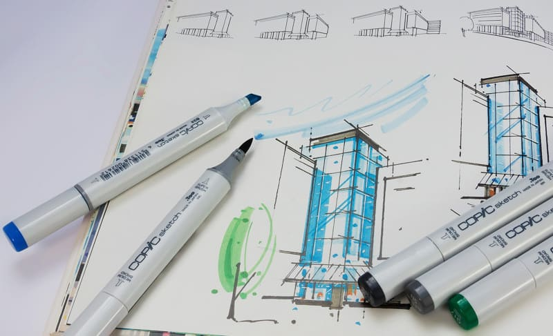 pen markers and a blueprint