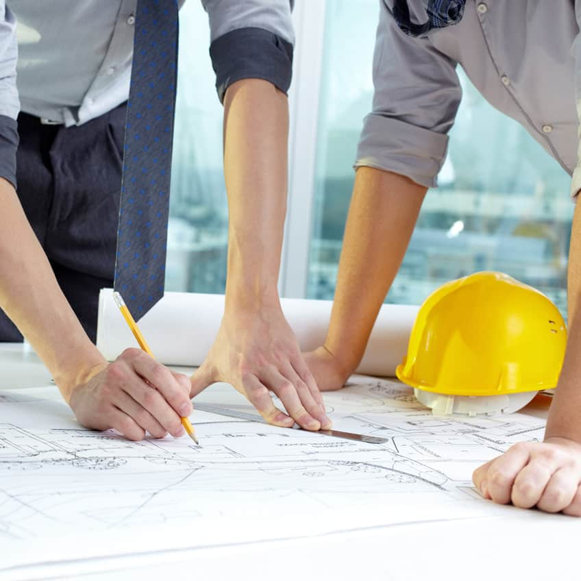 two people working on a blue print