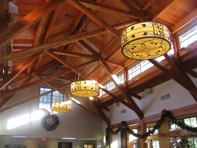 lighting fixtures hanging from a building's high ceiling