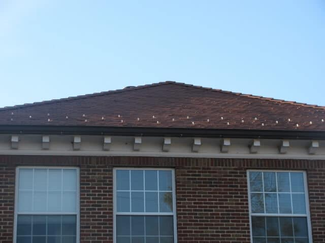 a brick home with low slope roof